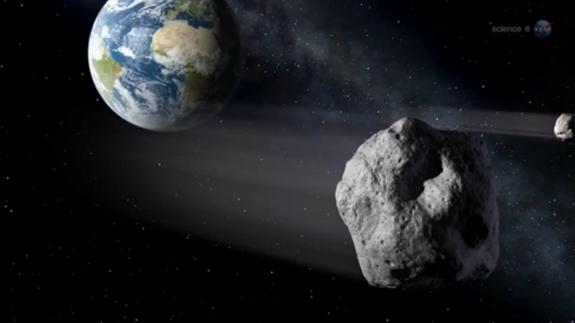 ภาพวาดจำลองเมื่อดาวเคราะห์น้อย 2012 DA14 เข้าใกล้โลก (นาซา/สเปซด็อทคอม)
