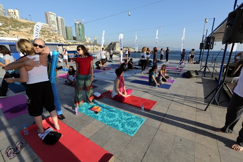 Beirut, LEBANON: People attend a yoga class aimed at raising awarness and funds for children with Congenital Heart Disease, in the Lebanese capital, Beirut on May 1, 2014. AFP PHOTO/Anwar Amro