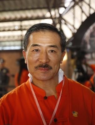 H.E. Mr.Kesang Wangdi