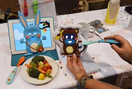 Las Vegas, Nevada, UNITED STATES: Slow Controls Yum & Done, the first smart spoon and a cuddly toy to help make kids eat their vegetables, is displayed during a press event for CES 2016 at the Mandalay Bay Convention Center on January 4, 2016 in Las Vegas, Nevada. A button on the Bluetooth-enabled spoon activates an app on a smartphone or tablet that is covered by a cuddly toy to keep a childs attention while being fed from the spoon. Ethan Miller/Getty Images/AFP
