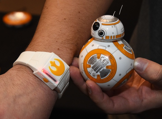 Las Vegas, Nevada, UNITED STATES: Spheros BB-8 technical prototype with Force Band is displayed during a press event for CES 2016 at the Mandalay Bay Convention Center on January 4, 2016 in Las Vegas, Nevada. Sphero partnered with Lucasfilm to build the US$150, app-enabled toy from the droid character in the film Star Wars: The Force Awakens. It can be controlled using Bluetooth by a smartphone or the Force Band and features gesture-based technology enabling users to control it with Jedi-like movements. Ethan Miller/Getty Images/AFP