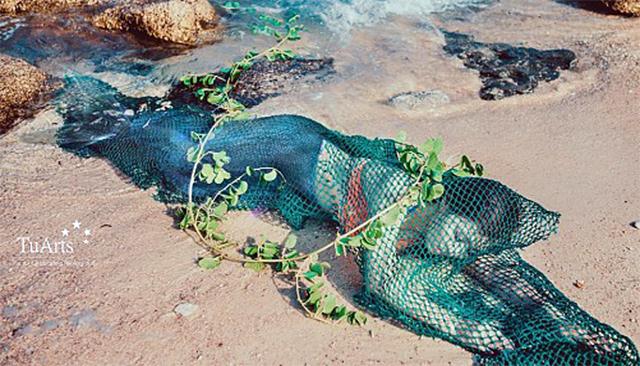 เวียดนามรวบหนุ่มตัวการ เจ้าของรูปถ่ายเงือกสาวติดอวนตังเกจากทะเลจีนใต้