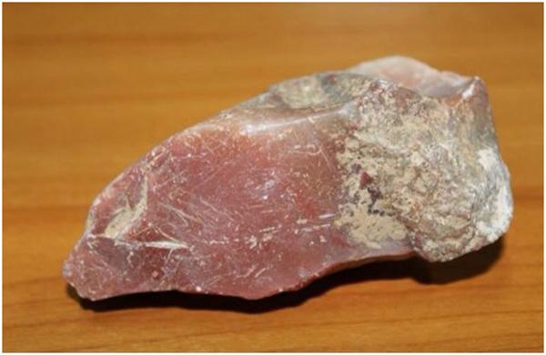 <br><FONT color=#000033>หินอ่อนสีขมพูนภาพประกอบข่าวจากแขวงอัตตะปือ ในหนังสือพิมพ์เวียงจันทน์ใหม่ 16 ต.ค.2557.</b>