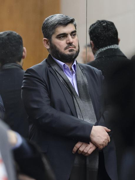 โมฮาเหม็ด อัลลูช หัวหน้าคณะผู้แทนเจรจาของกองทัพแห่งอิสลาม (Army of Islam) ซึ่งเป็นองค์กรกบฏกลุ่มใหญ่ในซีเรีย