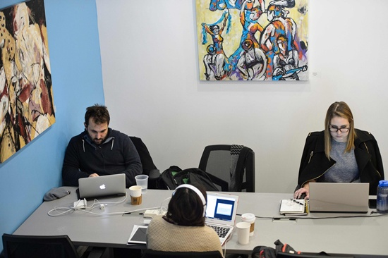 Washington, District of Columbia: People work at the coworking space Cove on February 10, 2016 in Washington, DC. In Washington and in communities around the world, growing numbers are turning to this new kind of work environment, sharing office space with people from various fields and using their smartphones and laptops as portable offices. AFP/Brendan Smialowski