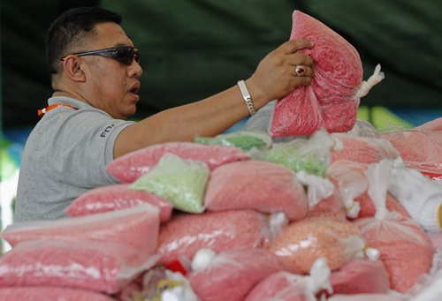 Thai forager who found $6m pill stash 'gave them away' to pals