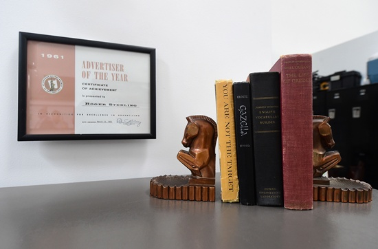Culver City, California, United States: A Roger Sterling certificate and Don Drapers books and bookends are displayed among items from the American drama series Mad Men at ScreenBid, an online auction house partnering with Hollywood studios to sell collectibles from the set, in Culver City, California on May 26, 2016 ahead of the two-week sale of items which begins on June 1. AFP/Frederic J. Brown