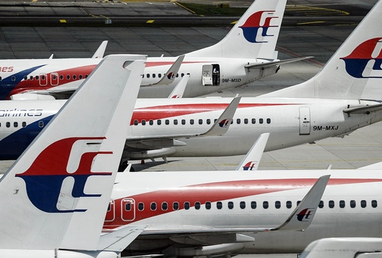 An unspecified number of passengers and crew were injured when a Malaysia Airlines flight from London to Kuala Lumpur was hit by severe turbulence, the carrier said, as photos emerged showing a cabin strewn with debris and upended meal carts. -- Photo: AFP