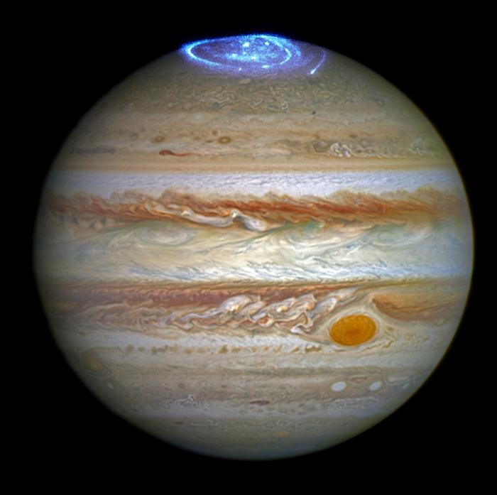 ภาพแสงออโราบนขั้วเหนือของดาวพฤหัสที่บันทึกด้วยกล้องฮับเบิล Handout / NASA, ESA, J. Nichols (University of Leicester) / AF