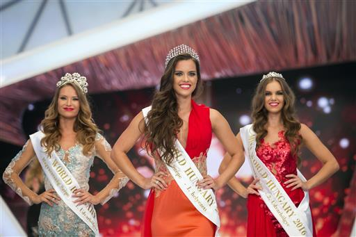 Second placed Eszter Oczella, winner Timea Gelencser and third placed Babett Dukai, from left, pose on the stage during the final of the Miss Hungary beauty pageant, in Budapest, Hungary, Sunday, July 17, 2016. (Balazs Mohai/MTI via AP)