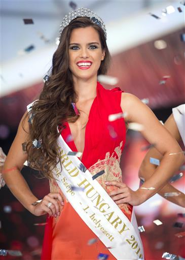 Winner Timea Gelencser poses on the stage after she was crowned during the final of the Miss Hungary beauty pageant, in Budapest, Hungary, Sunday, July 17, 2016. Timea Gelencser will represent Hungary at the 2016 Miss World final in Washington in December. (Balazs Mohai/MTI via AP)