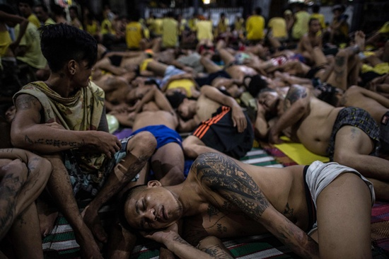 Manila: Inmates sleep on the ground inside the Quezon City jail at night in Manila in this picture taken on July 21, 2016. AFP/Noel Celis
