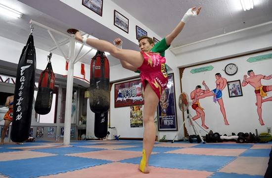Tokyo: This photo taken on July 5, 2016 shows Thai martial arts Muay Thai fighter Ayaka Miyauchi of Japan shadowboxing at her gym in Tokyo. AFP/Toru Yamanaka