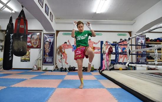 Tokyo: This photo taken on July 5, 2016 shows Thai martial arts Muay Thai fighter Ayaka Miyauchi of Japan training at her gym in Tokyo. AFP/Toru Yamanaka