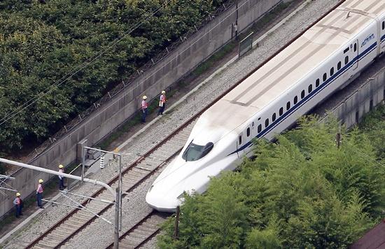 Japan bullet train driver puts feet up on the job