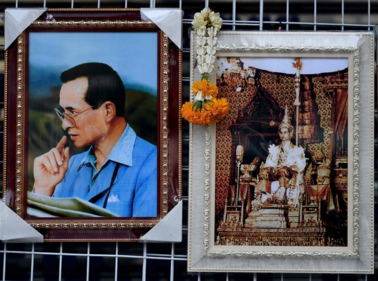 Bangkok: A garland is hung on a portrait of Thailands King Bhumibol Adulyadej outside the Siriraj Hospital in Bangkok on October 14, 2016. King Bhumibol Adulyadej, long a unifying figure in politically fractious Thailand, died on October 13 and uncertainty over the succession quickly arose as his crown prince reportedly sought a delay in taking over. AFP/Manan Vatsyayana