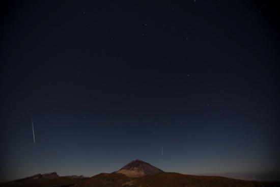 Santiago del Teide, Spain: Shooting stars cross the sky during the Geminids, a meteor shower above the National Park of El Teide, on the Spanish canary island of Tenerife on December 14, 2016. AFP/Desiree Martin