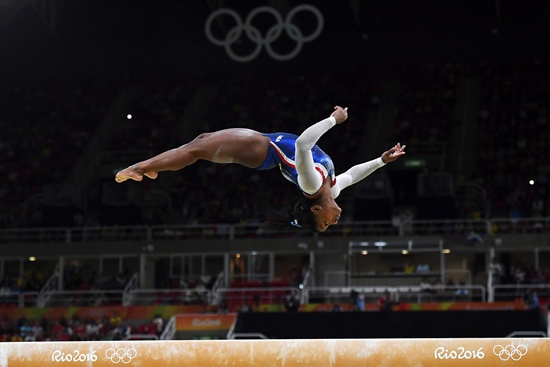 Rio de Janeiro: (FILES) This file photo taken on August 11, 2016 shows US gymnast Simone Biles competing in the beam event of the womens individual all-around final of the Artistic Gymnastics at the Olympic Arena during the Rio 2016 Olympic Games in Rio de Janeiro. AFP/Ben Stansall