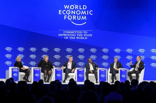 Davos, Graubunden, Switzerland: (From L) Editor-in-Chief of The Economist Zanny Minton Beddoes, Prime Minister of Norway Erna Solberg, Director of Wellcome Trust Jeremy Farrar, President of Guinea Alpha Conde, US philanthropist Bill Gates of the Bill & Melinda Gates Foundation and GlaxoSmithKline CEO Sir Andrew Witty attend a session on the third day of the annual meeting of the World Economic Forum on January 19, 2017 in Davos. AFP/Fabrice Coffrini