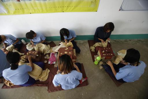 In this Jan. 6, 2017 photo, transgender inmates learn embroidery at Pattaya Remand Prison in Pattaya, Chonburi province, Thailand.  (AP Photo/Sakchai Lalit)
