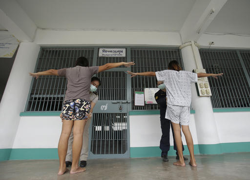 In this Jan. 6, 2017 photo, transgender inmates get a security check from female officers before entering their cell at Pattaya Remand Prison in Pattaya, Chonburi province, Thailand. (AP Photo/Sakchai Lalit)