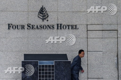 A member of staff walks outside the Four Seasons Hotel in Hong Kong on February 1, 2017. A Chinese billionaire has been abducted in Hong Kong by mainland agents, according to reports on January 31, triggering more concerns over security in the city after the disappearance of five booksellers. Financier Xiao Jianhua, founder of Beijing-based Tomorrow Group, was staying long-term at Hong Kongs luxury Four Seasons hotel, according to reports in overseas Chinese-language media. Anthony Wallace/AFP
