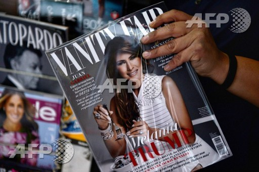 A newspaper vendor shows the February 2017 issue of the Mexican edition of Vanity Fair with the US first lady Melania Trump in the cover, at their stand in Mexico City on January 30, 2017. Pedro Pardo/AFP
