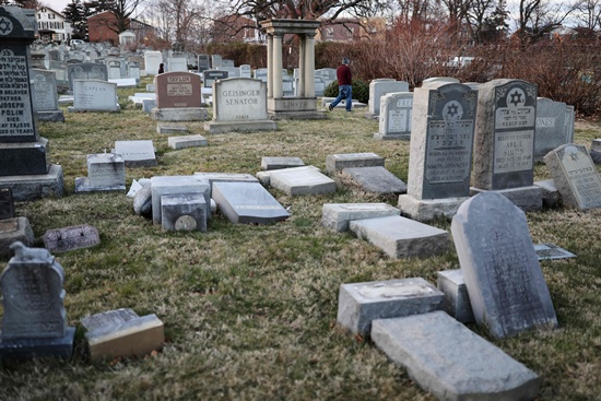 Philadelphia, Pennsylvania: Vandalized tombstones are seen at the Jewish Mount Carmel Cemetery, February 26, 2017, in Philadelphia, PA. Police say more than 100 tombstones were vandalized a week after a Jewish cemetery in St. Louis was desecrated. AFP/Dominick Reuter