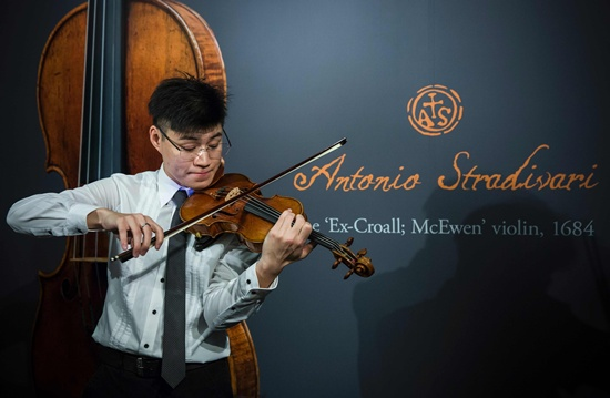 Hong Kong: A violinist plays a rare 1684 violin by Antonio Stradivari during a media preview at Sothebys in Hong Kong on February 21, 2017, ahead of the violins auction on March 28 in London where it is estimated to fetch US$1.55-US$2.45 million.  AFP/Isaac Lawrence