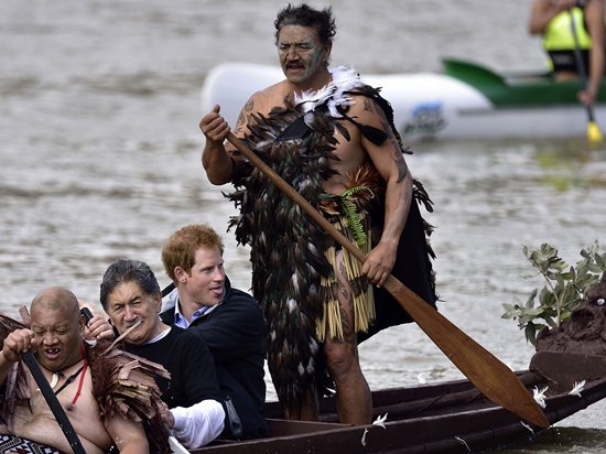 Whanganui, New Zealand: (FILES) This file photo taken May 14, 2015 shows Britains Prince Harry (2nd R) paddling in a waka (Maori war canoe) on the Whanganui river during a visit to Whanganui. A New Zealand river revered by Maori has been recognised by parliament as a legal person, in a move believed to be a world first. Under legislation passed March 15, 2017 that combines Western legal precedent with Maori mysticism, the Whanganui river has been formally declared a living entity. AFP/Marty Melville
