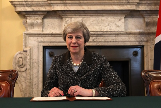 London: Britains Prime Minister Theresa May, signs the official letter to European Council President Donald Tusk, invoking Article 50 and signalling the United Kingdoms intention to leave the EU, in the cabinet office inside 10 Downing Street on March 28, 2017.. British Prime Minister Theresa May will send a letter to EU President Donald Tusk with Britains formal departure notification on Wednesday, opening up a two-year negotiating window before Britain actually leaves the bloc in 2019. AFP/Pool/Christophere Furlong