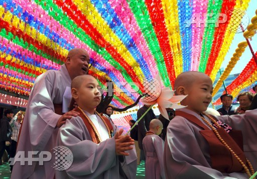 A young novice monk holds a lotus flower during a ceremony entitled Children Becoming Buddhist Monks, at the Jogye temple in Seoul on April 19, 2017. Following the ceremony the children stay at the temple where they are taught about Buddhism for two weeks ahead of celebrations for Buddhas birthday on May 3 this year. Jung Yeon-Je/AFP