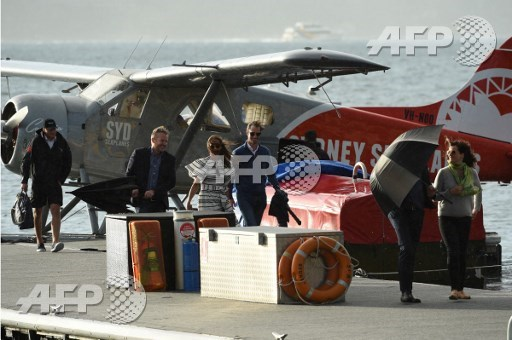 Pippa Middleton (C) and her husband James Matthews (centre R) arrive at Rose Bay Wharf by sea plane in Sydney on May 31, 2017. Pippa and Matthews, who married on May 20, 2017, are visiting Sydney on their honeymoon. Saeed Khan/AFP