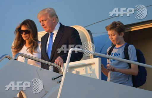 After delay, Trump's family joins him in White House