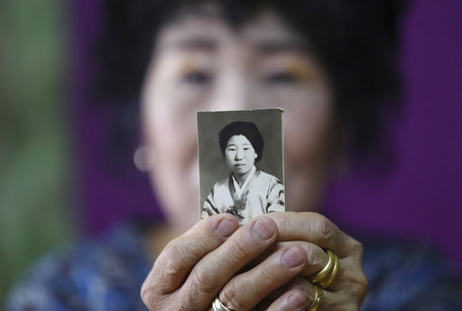 In this July 11, 2017 photo, South Koreas YouTube star, Park Makrye, 70, shows her teenage photo at her home in Yongin, South Korea. Parks videos are all about showing off her wrinkles and her elderly life in the raw. Young South Koreans find her so funny and adorable that big companies like Samsung Electronics and Lotte are banking on her popularity. But despite her new life as a celebrity, she still gets up before dawn to run her diner. (AP Photo/Lee Jin-man)