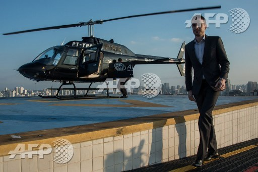 Brazilian businessman Gustavo Boyle prepares to board a helicopter in Sao Paulo, Brazil on June 23, 2017 Airbus subsidiary Voom gives an alternative for those willing to avoid Sao Paulos heavy car traffic, offering a helicopter service similar to the car service offered by Uber. Nelson Almeida/AFP