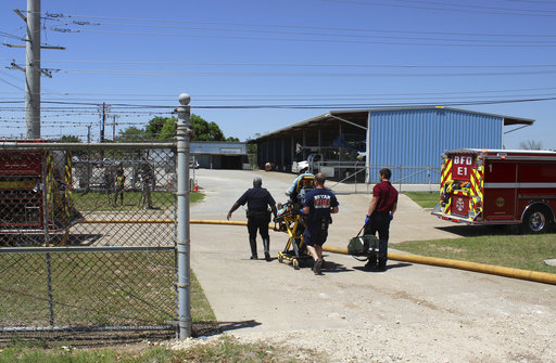 In this photo provide by the Bryan, Texas Fire Department, taken April 29, 2014, Bryan Texas firefighters transport injured worker in a stretcher to the ambulance. An explosion at the Bryan Texas Utilities Power Plant left a 60-year-old employee dead and two injured. (Bryan, Texas Fire Department via AP)