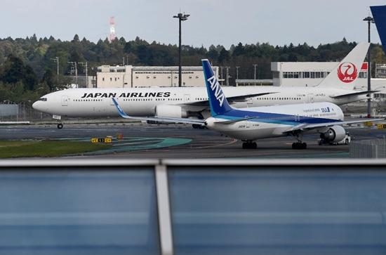 Japan Airlines flight makes emergency landing in Tokyo