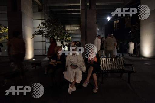 Guests of a hotel remain outside in downtown Mexico City during an earthquake on September 7, 2017. An earthquake of magnitude 8.0 struck southern Mexico late Thursday and was felt as far away as Mexico City, the US Geological Survey said, issuing a tsunami warning. It hit offshore 120 kilometers (75 miles) southwest of the town of Tres Picos in the state of Chiapas. Pedro Pardo/AFP