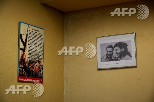 A picture taken on September 8, 2017 shows the local of the Marinaleda Workers Union with a picture of late Argentinian revolutionary legend Ernesto Che Guevara (R) and former Cuban leader Fidel Castro, in Marinaleda, southern Spain. Cristina Quicler/AFP