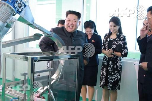N. Korea's Kim tours cosmetics plant with wife, sister