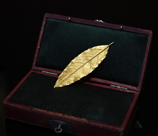 This picture taken on November 15, 2017 in Paris shows a gold laurel leaf from the coronation crown of Emperor Napoleon I. The gold leaf is due to be auctionned at the Osenat auction house in Fontainebleau on November 19, 2017. Stephane de Sakutin/AFP