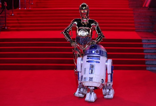 (FILES) This file photo taken on December 12, 2017 shows Star Wars characters C-3PO (L) and R2-D2 n the red carpet for the European Premiere of Star Wars: The Last Jedi at the Royal Albert Hall in London. Star Wars: The Last Jedi -- the latest episode in the blockbuster space saga -- has raked in more than $450 million worldwide since hitting theaters, Disney said December 18, 2017. The film -- which features the late Carrie Fishers final performance as Princess Leia -- took in $220 million in North America, and another $230.8 million overseas, a Disney spokesman said. It was the fifth biggest global box office debut in history, the company said. Daniel Leal-Olivas/AFP
