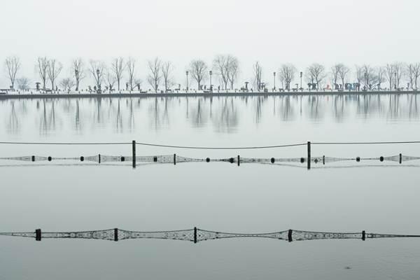 วิวเหมันต์ฤดูทะเลสาบซีหู เมืองหังโจว มณฑลเจ้อเจียง ภาพ 25 ม.ค. (ภาพ ซินหวา)