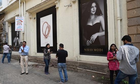 Indian investigators raid billionaire jeweller's offices