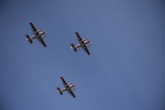 Three Beechcraft TC90 aircraft from the Japan Ministry of Defence (JMOD) fly in formation as they arrive at the Naval Air Group headquarters at Sangley Point in Cavite, south of Manila on March 26, 2018. Noel Celis/AFP
