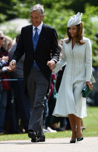 (FILES) In this file photo taken on May 20, 2017, David and Jane Matthews, parents of the groom, attend the wedding of Pippa Middleton and their son James Matthews at St Marks Church in Englefield, west of London. The father-in-law of Pippa Middleton, whose sister Kate is married to Britains Prince William, has been charged in France with the rape of a minor, a legal source told AFP on March 30, 2018. David Matthews was taken into custody for questioning last March 27, 2018 by investigators with Frances Minor Protection Brigade in a case dating from 1998-99, after a complaint was lodged in 2017, the source said. Justin Tallis/Pool/AFP