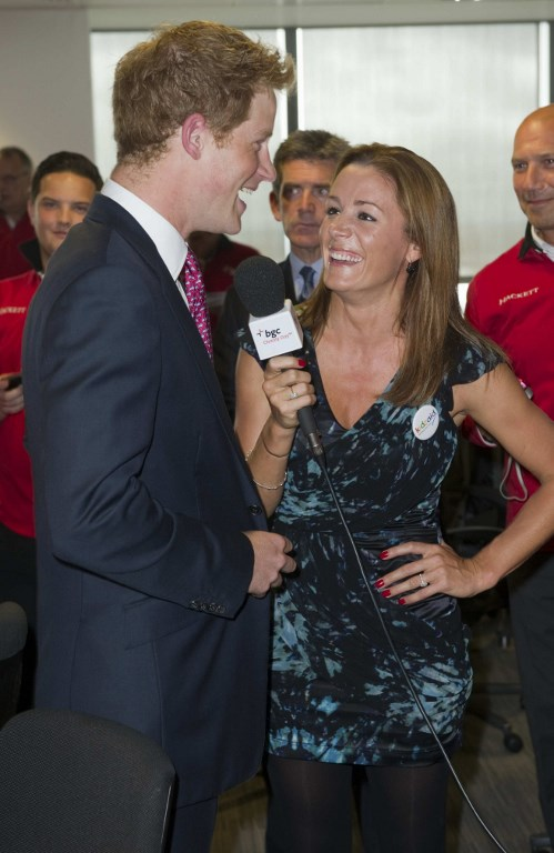 (FILES) In this file photo taken on September 12, 2011 Britains Prince Harry talks to British TV and radio presenter Natalie Pinkham on the trading floor as he attends BGC Partners Charity Day in London. Before he fell for American actress Meghan Markle, Britains Prince Harry, 33, had several other girlfriends. Paul Grover/Pool/AFP