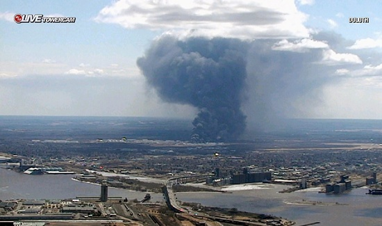 This image from video provided by WDIO-TV in Duluth, Minn., shows smoke rising from the Husky Energy oil refinery after an explosion and fire Thursday, April 26, 2018, at the plant in Superior, Wis. Authorities say several people were injured in the explosion. (WDIO-TV via AP)