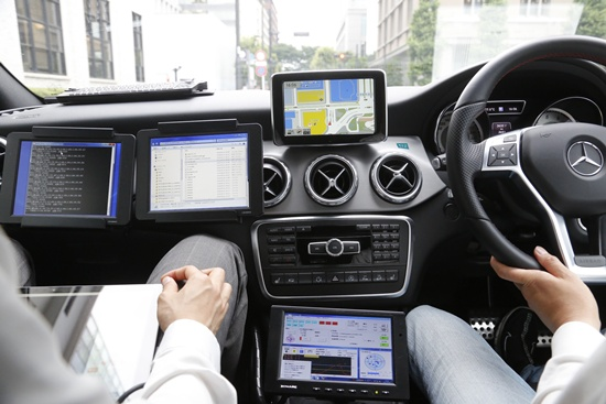 In this May 31, 2018, photo, a car monitor shows a 3D digital map as its driven through Tokyo streets. (AP Photo/Yuri Kageyama)